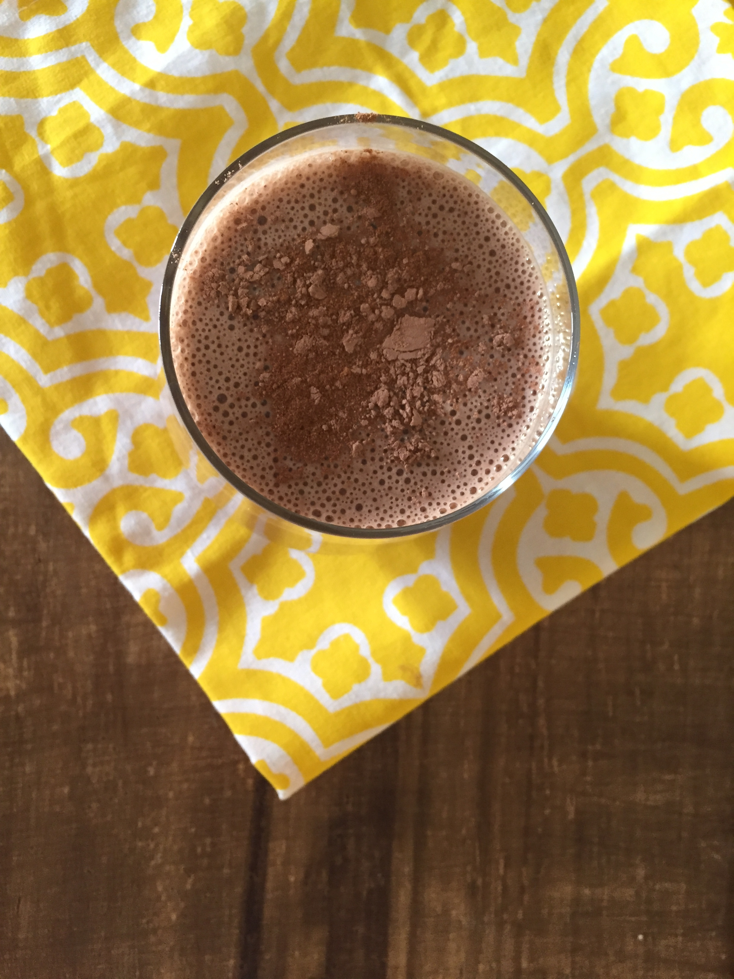 Cacao and banana smoothie in a glass.