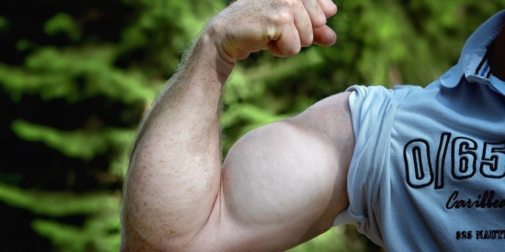Man's flexed arm muscle.