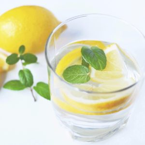 Glass of water infused with lemon and mint.