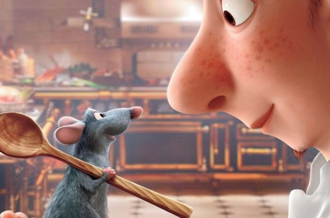 "Still image of the animated movie ""Ratatouille"" with the two main characters, Remy and Linguini."