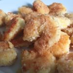 a plate of gluten free coconut shrimp