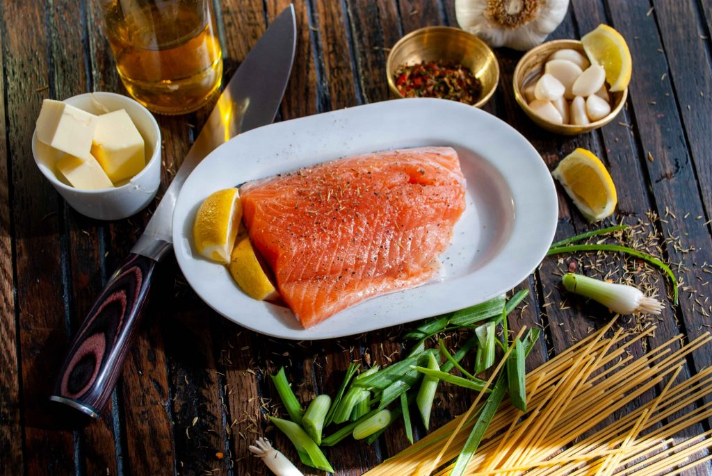 Piece of salmon signifying a dish that can be found in a pescatarian meal plan.